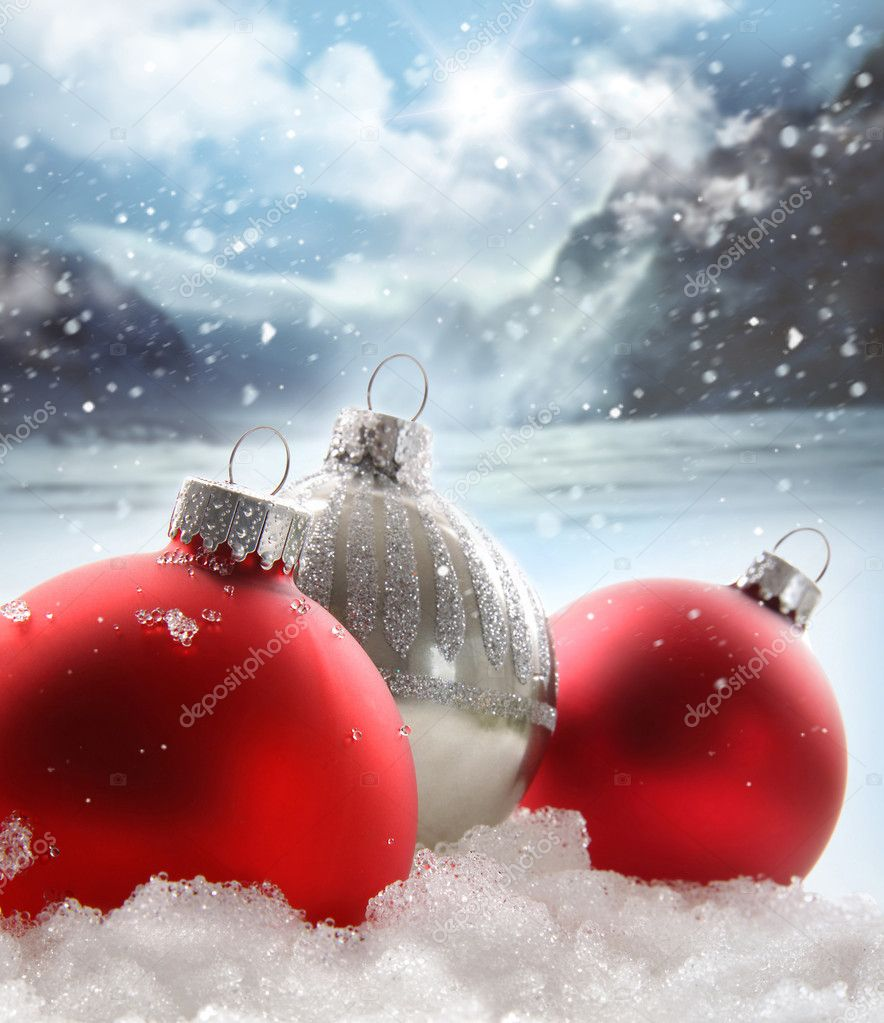Three red Christmas balls in the snow on white  Stock Photo #4340673