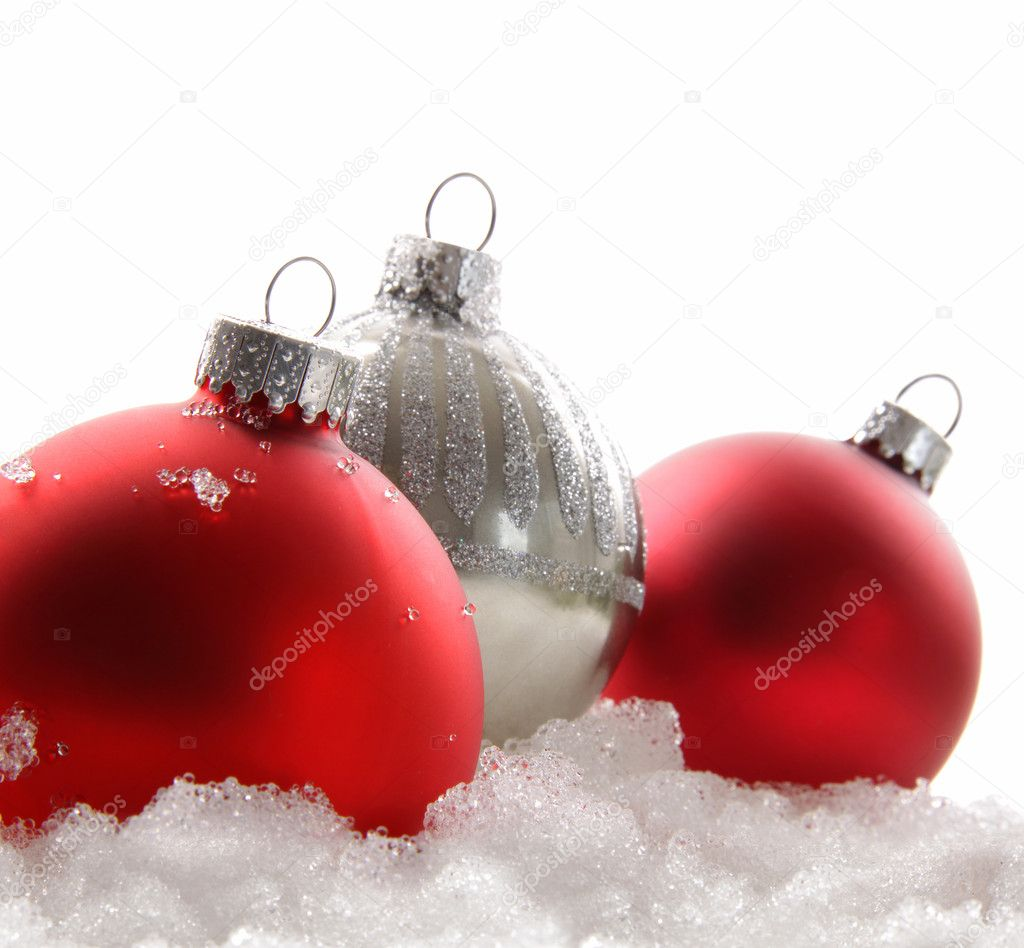 Three red Christmas balls in the snow on white — Stock fotografie #4340687