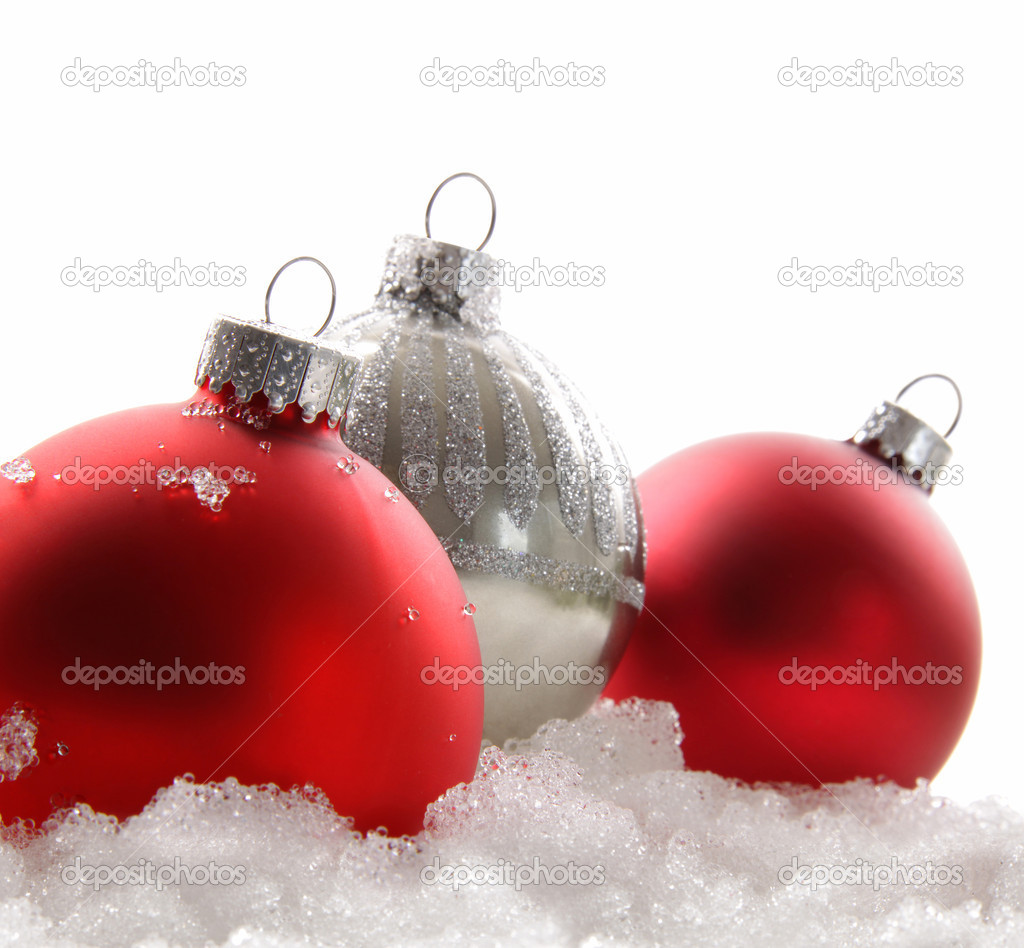 Three red Christmas balls in the snow on white — Stok fotoğraf #4340687