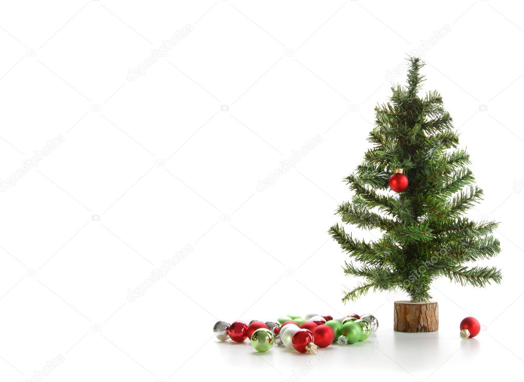 Small artificial tree with ornaments on white background — Stock Photo #4340692