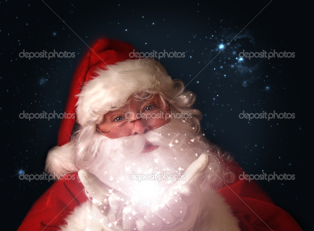 Santa holding magical Christmas lights in hands — Stock Photo #4340756