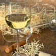 Royalty-Free Stock Photo: Glass of white wine with cork screw
