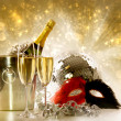 Two glasses of champagne against festive gold background - Stock Photo