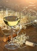 Glass of white wine with cork screw — Stock Photo