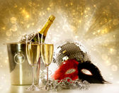 Two glasses of champagne against festive gold background — Stok fotoğraf