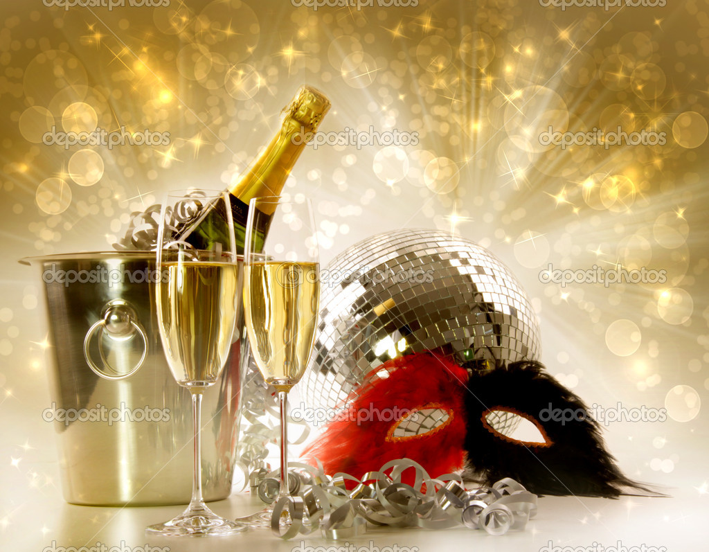 Two glasses of champagne and ice bucket against festive gold background  Stock Photo #4438994