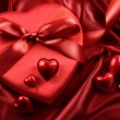 Box of chocolates with ribbons and hearts