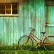 Digital Painting of old bicycle  against  barn - Stock Photo