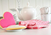 Heart-shape valentine cookies with teapot and cups — Stock Photo