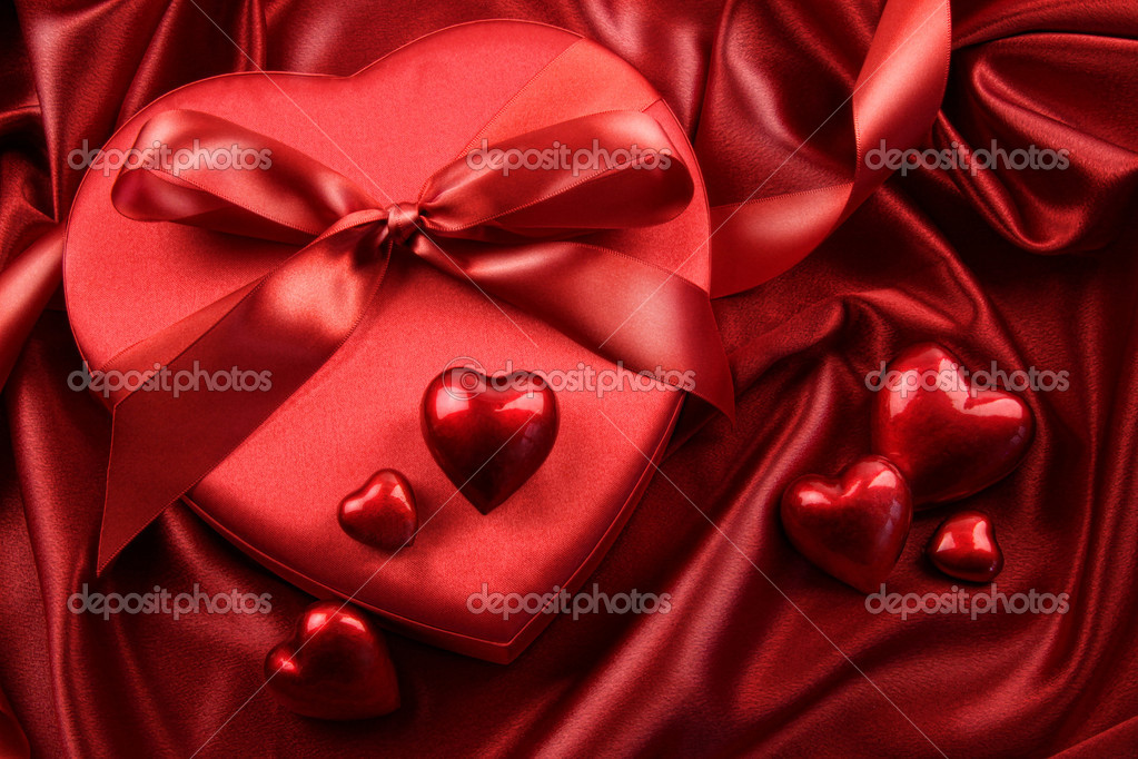 Box of chocolates with ribbons and hearts  Stock Photo #4640121