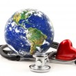 Stethoscope with globe on a white - Foto Stock