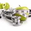 Green apples with stethoscope against white — Stock Photo #4687051
