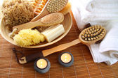 Spa brushes, sponges and soap on bamboo mat — Stock Photo