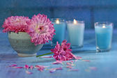 Chrysanthemum flowers with candles — Stock Photo
