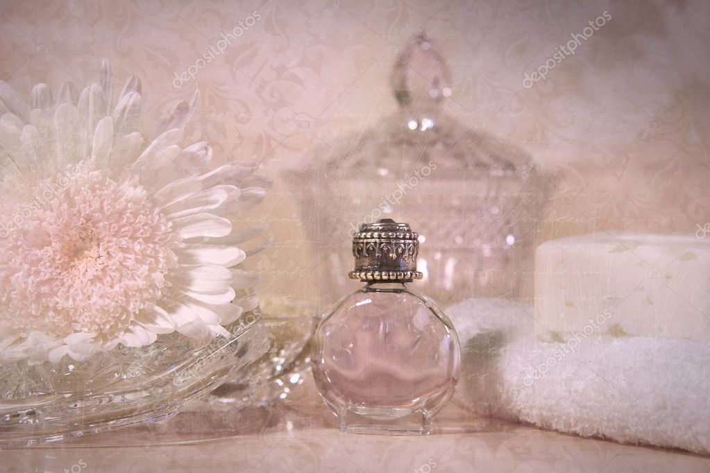 Vintage perfume bottle with flower and soap — Stock Photo #4969740