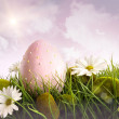 Royalty-Free Stock Photo: Large pink easter with flowers in tall grass