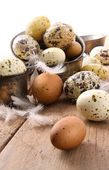 Brown and white speckled eggs on table — Stock Photo