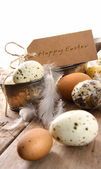 Brown speckled eggs with easter card — Stock Photo