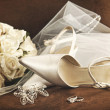 Wedding shoes with bouquet of white roses and ring - Stok fotoğraf