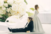 Whimsical wedding cake figurines on white — Stock Photo