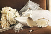 Wedding shoes with bouquet of white roses and ring — Stock Photo