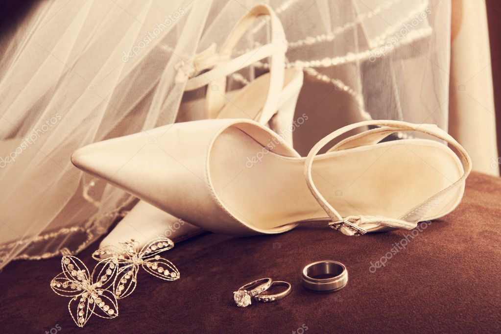 Wedding shoes with veil and rings on velvet chair  Stock Photo #5345595