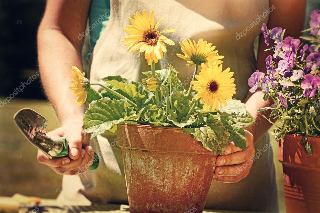 Woman doing garden work with vintage look feel — Stockfoto #5345640