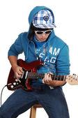 Teen boy with guitar. — Stock Photo