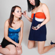 Two Chinese girls doing makeup. — Stock Photo #4535443