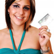 Smiling young girl with her credit card. — Stock Photo