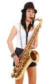 Chinese girl playing the saxophone. — Stock Photo