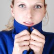 Pretty lady in blue coat. — Stock Photo #4576969