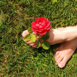 Woman feet with rose. — Foto de Stock