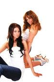 Two girls kneeling. — Stock Photo