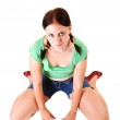 Pretty girl in shorts kneeling on the floor. — Stock Photo #4620732