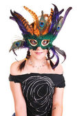 Young girl with feather mask. — Stock Photo