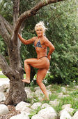 Bodybuilding woman on location. — Stock Photo