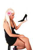 Blond woman with black heel. — Stock Photo