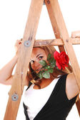 Pretty girl under the stepladder. — Stock Photo