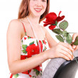 Pretty girl in dress with rose. — Stock Photo