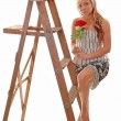 Girl on stepladder. — Stock Photo