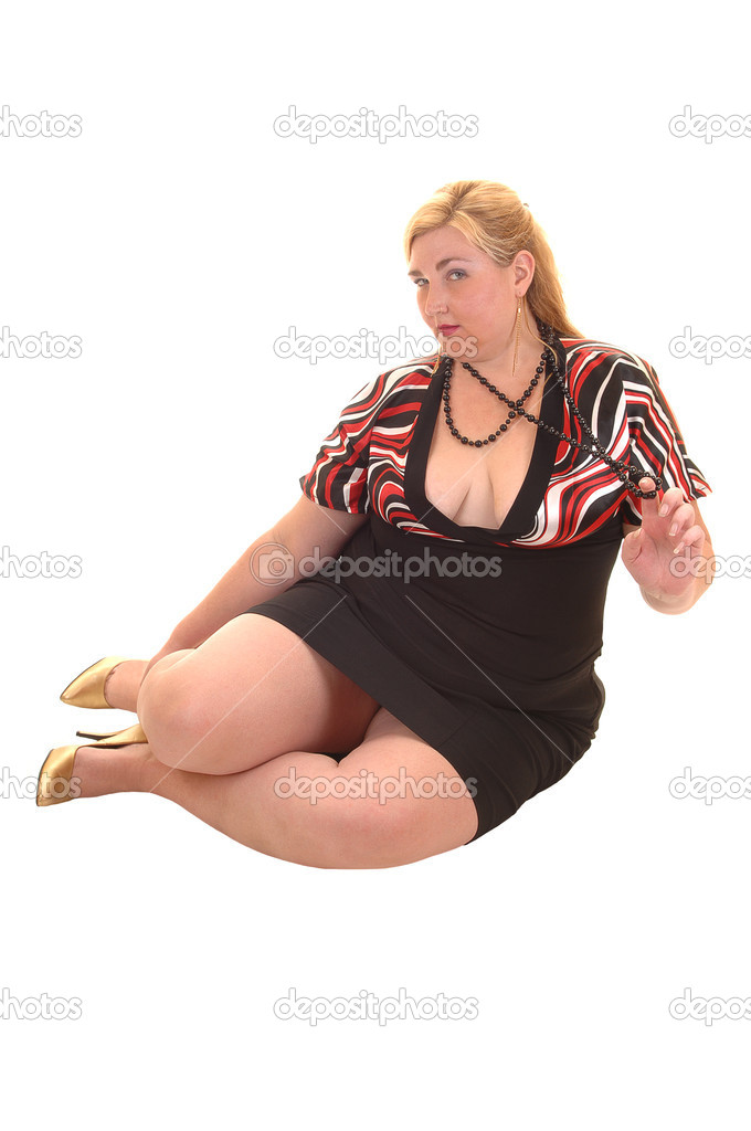 An heavy woman sitting on the floor in a black dress, for white background. — Stock Photo #4968051