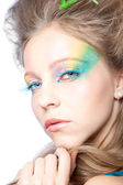 Beautiful woman with color makeup — Stock Photo