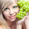 Young girl with grape — Foto Stock