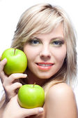 Young girl with apples — Stock Photo