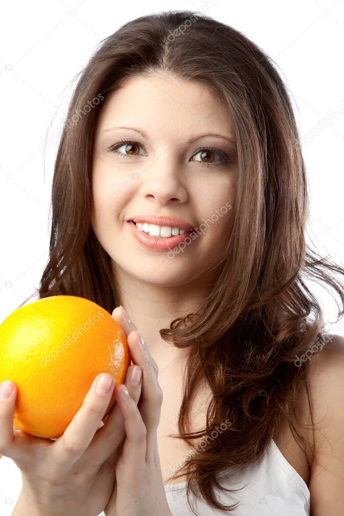 Beautiful young woman holding an orange. Close up — Stock Photo #4440098
