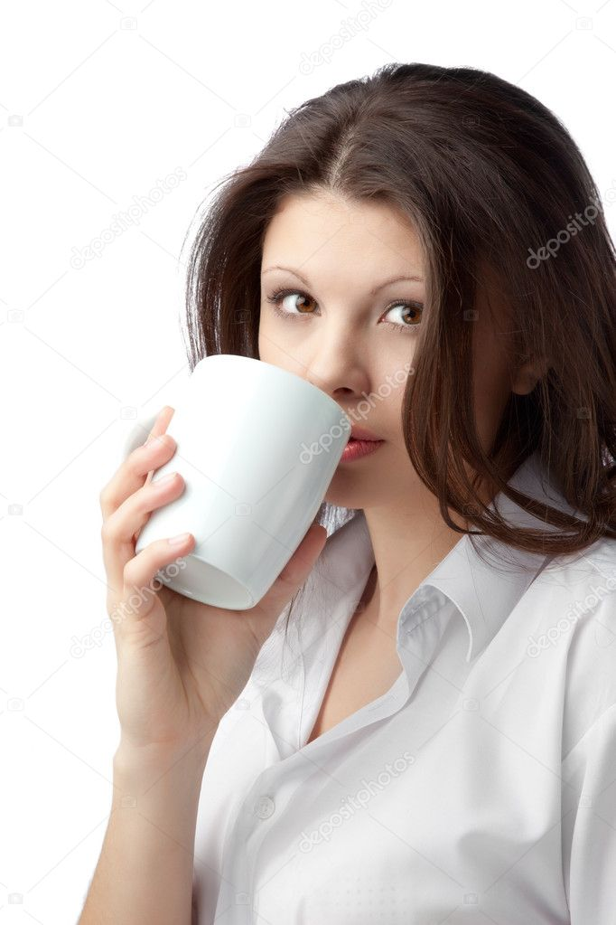 A beautiful young female woman enjoying a cup of tea/coffee  Stock Photo #4458696
