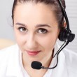 Woman with headset over white background — Stock Photo