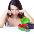 Young girl with  vegetables - Stock Photo