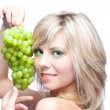 Young girl with grape - Stock Photo